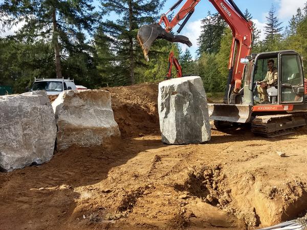 excavator-lifting-rocks